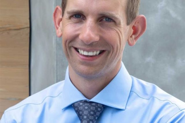 profile photo of cooper lord smiling wearing blue dress shirt and tie